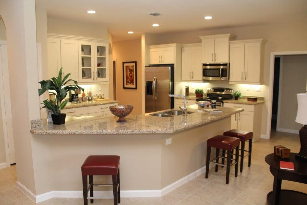 D r horton southeast florida unveils new model at palma for Model home kitchen images